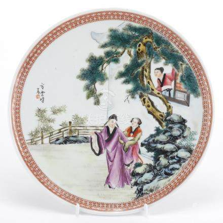 Chinese porcelain footed plate, hand painted in the famille rose palette with three figures in a