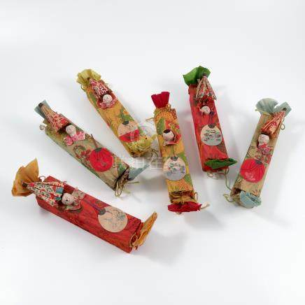 A set of six Oriental crackers, of rectangular form, covered with a printed crepe paper and each