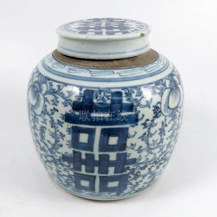 An Oriental covered ginger jar, decorated in blue and white with foliage, height 7ins