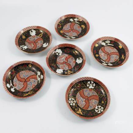 A set of six 19th century Japanese porcelain saucer dishes, decorated in gilt and enamel with birds,