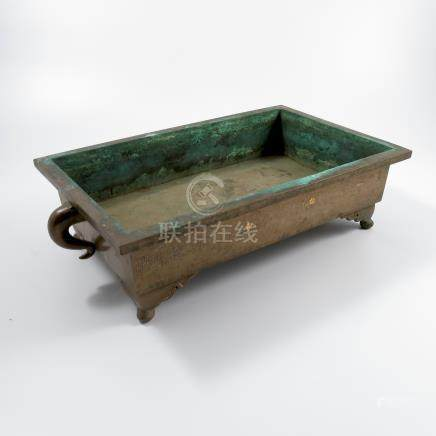 A brass Oriental plant stand, of rectangular form, with curved handles and band of decoration and