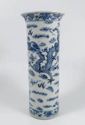 A Chinese cylindrical shaped vase, in blue and white, decorated with dragons, height 11.25ins