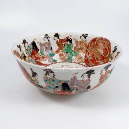 An Oriental bowl, decorated with figures flanking a medallion of dragons and a crane, diameter 9.