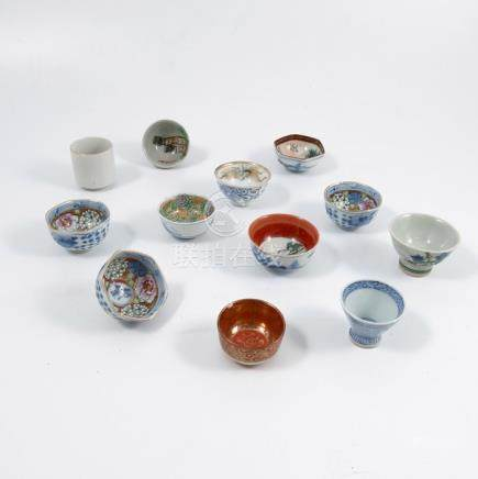 A collection of twelve small Oriental decorative tea bowls