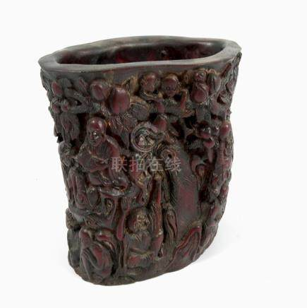 An Eastern resin vase, in carved relief with elephant mask handles, height 12ins