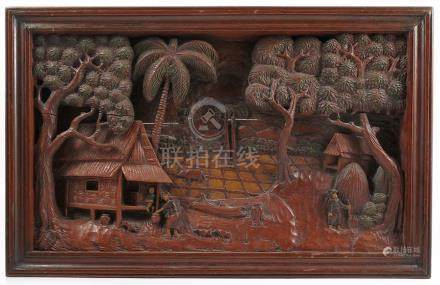 An Oriental rectangular wooden panel, carved in relief with figures within a landscape, 14ins x 22.