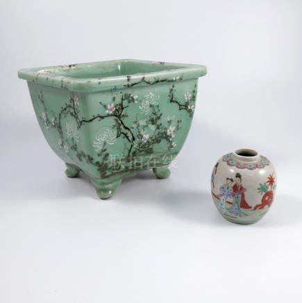 An Oriental celadon ground jardinière, of square form, decorated with prunus, width 10.5ins,