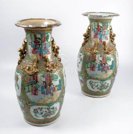 A pair of Cantonese vases, with reserve panels of figures and insects to a typical ground, af,