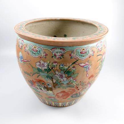 An Oriental carp bowl, decorated with fish to the interior and foliage and birds to the exterior,
