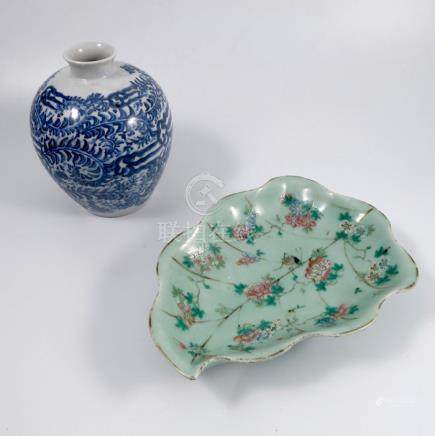 An Oriental celadon leaf dish, decorated with flowers and insects, length 11.5ins, together with a