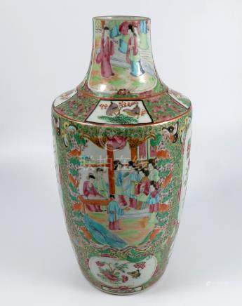 A Cantonese vase, decorated with figures and birds within panels, to a typical ground, reduced in
