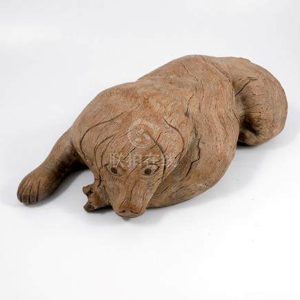 An Eastern, probably Chinese hardwood root carving, of a dog, length 17ins