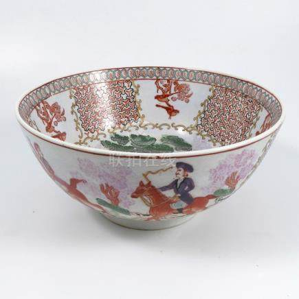 An Oriental hunting bowl, decorated to the interior and exterior with figures on horseback and