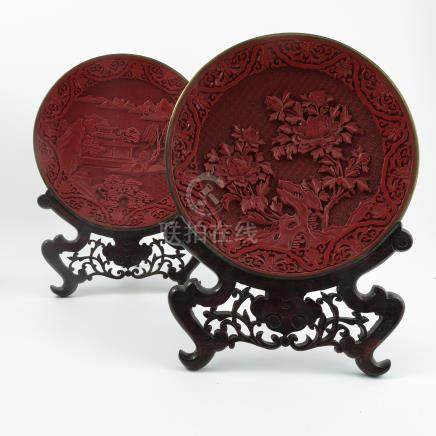 Two cinnabar lacquer plates, decorated with foliage and landscape, diameter 10ins