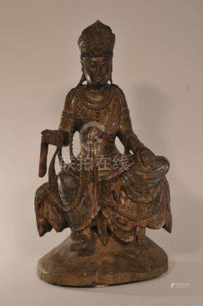Wood carving. China. 19th century. Seated figure of