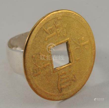 Chinese gold coin mounted as a ring. Tests as 9K,