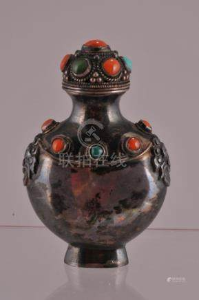 Silver snuff bottle. China. Early 20th century. Mongol