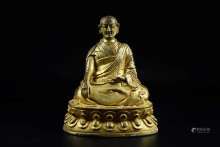 GILT BRONZE CAST GURU SEATED FIGURE
