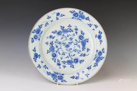 An 18th century Chinese blue and white plate decorated with flowers and numbered by hand