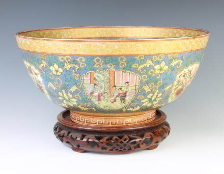 A modern famille rose porcelain bowl decorated with panels of figures in pavilions and flowers 35cm,