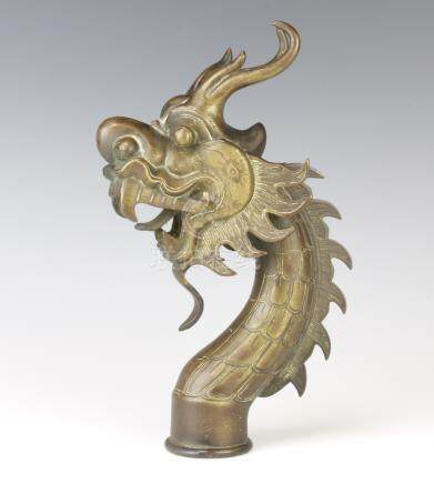 A 19th Century Chinese bronze staff head in the form of a dragon 22cm