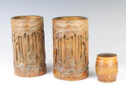 A turned wooden trinket box in the form of a barrel 6cm x 4cm and a pair of Chinese carved bamboo