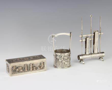 A Chinese repousse silver pail decorated with lilies 7cm, an Indian repousse silver rectangular