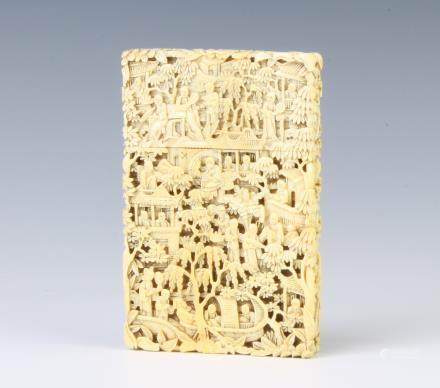 A 19th Century carved Cantonese ivory card case depicting figures before pavilions amongst flowering