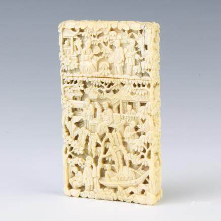 A 19th Century Cantonese carved ivory card case depicting figures before pavilions 9cm x 5cm x 1cm