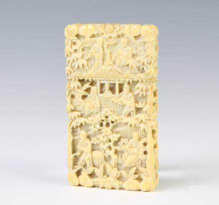 A 19th Century Cantonese carved ivory card case depicting figures before pavilions 8cm x 4.5cm x 1cm