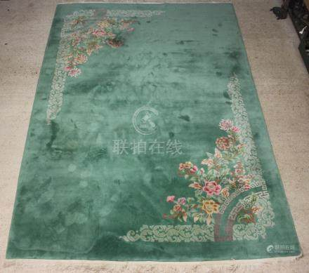 A 1930's green and floral patterned Chinese carpet 187cm x 122cm