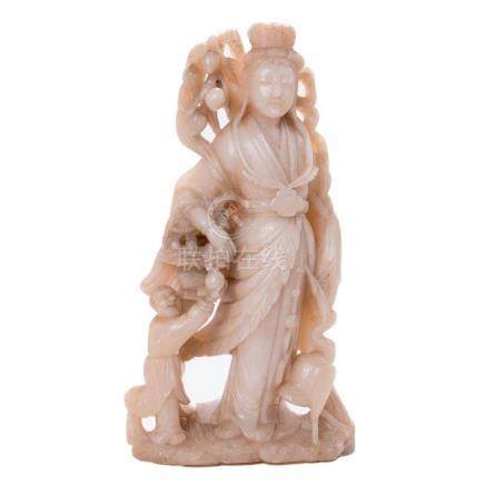 A large Chinese jade carving of a goddess.