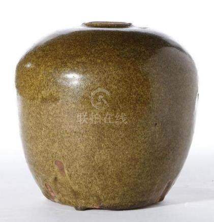 A 15th century Chinese Ming period tea-dust glazed jar.