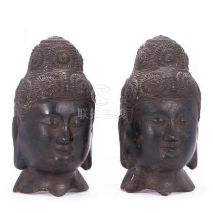 Two Chinese bronze Buddha heads.