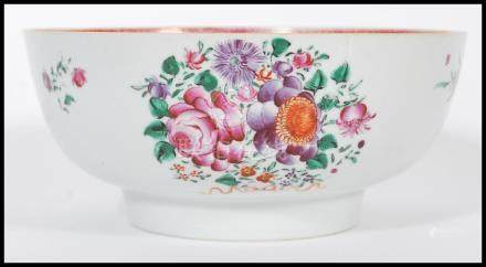 An 18th century Cantonese large Chinese ceramic bowl having hand painted floral sprays and famille
