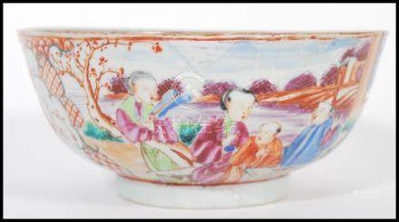 An 18th Chinese ceramic bowl having hand painting white cartouche panels depicting birds and trees