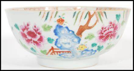 An 18th century small Cantonese Chinese ceramic bowl having hand painted floral spray with trees