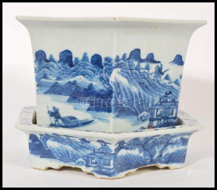 An 19th century blue and white ceramic Chinese jardiniere and stand having a hexagonal shape. Hand