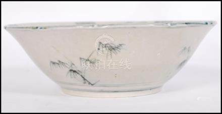 A 19th century Chinese bowl having decoration of maiden with plants and geometric borders. Six