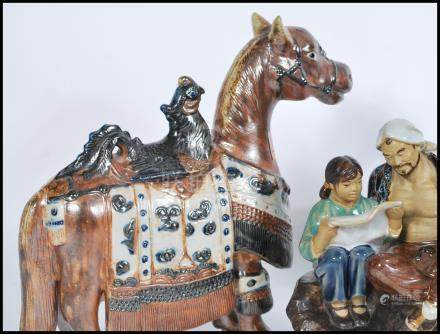 A 20th Century ceramic Tang Dynasty style War Horse, the horse surmounted by a Phoenix, together
