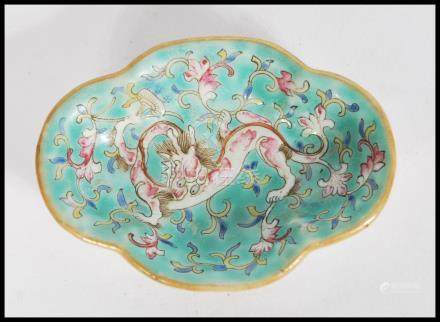 A 19th century Chinese small brush water dish having hand painted and enamelled with dragon and