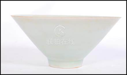 A believed antique Chinese Celadon glaze bowl of conical form raised on small circular foot.