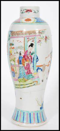 An early 20th century Chinese vase of bottle shape having cartouche panels depicting domestic