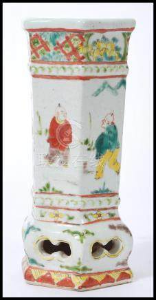 A 19th century Chinese pottery vase of hexagonal form having cartouche panels depicting typical