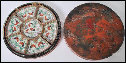 An early 20th century Chinese porcelain horderves sectional set of serving dished housed within a