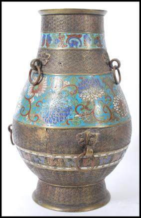 A large early 20th Century oriental Chinese champleve bronze enamelled vase of bulbous form having