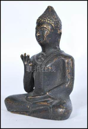 A 19th century Chinese bronze statue figure of a Buddha modelled in the Lotus position. Measures
