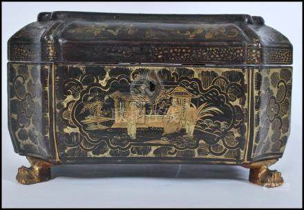 A 19th century Chinese lacquer box raised on ormolu claw feet. The box of octagonal sarcophagus