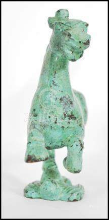 A 19th century Tang Dynasty style Chinese bronze patinated figurine of a warhorse / war horse raised