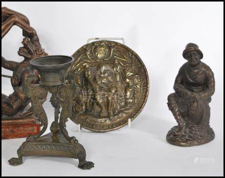 A collection of bronze and bronzed items to include a naked entwined couple, a Chinese incense